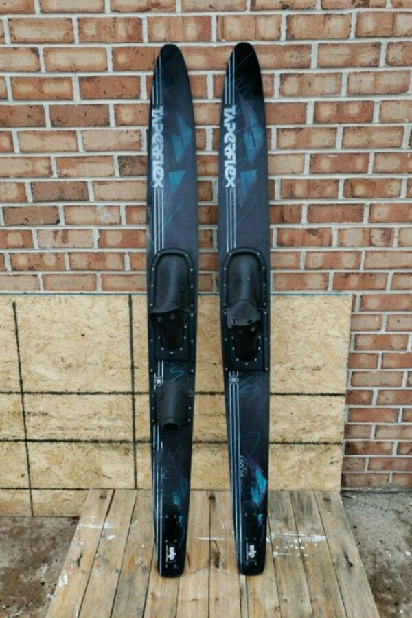 Water skis.  5e856c85-cd0c-45b8-9f9d-77aef5f4e915