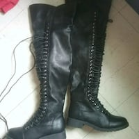 pair of women's black leather knee-high lace-up bo Winnipeg, R3B 2S6