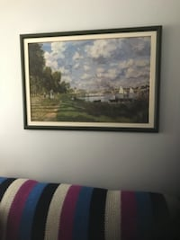 Green grass field painting with black wooden frame