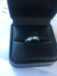 Silver-colored ring with black box