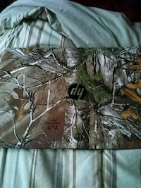 brown and green camouflage zip-up jacket 48 km