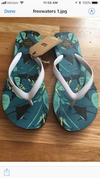 Women's free waters sandals in size 7 black or white Philadelphia, 19115