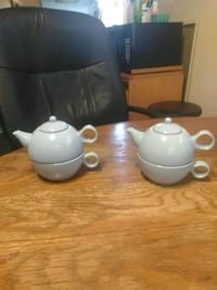 Tea pots with cups