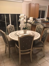 It's white stone table with sliver 6 chairs 799$ and 900$ table  Whitby, L1P 0A4