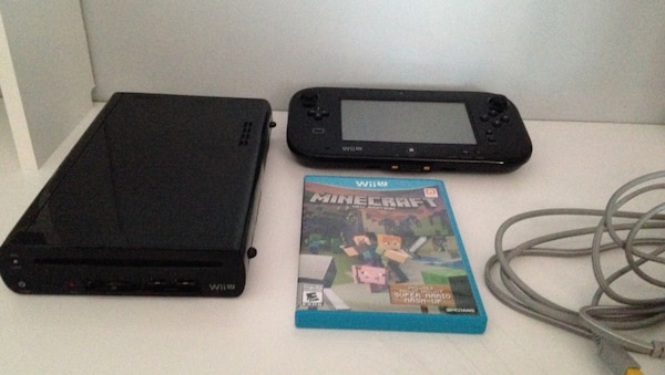 Nintendo Wii console with game