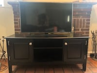 4K 40inch smart tv with wooden entertainment center  Falls Church, 22042
