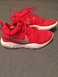 pair of red Nike running shoes 663 mi