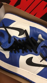 pair of blue-and-white Nike sneakers Toronto, M2N 7K2