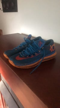 pair of blue-and-red Nike basketball shoes Fayetteville, 28314