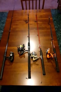 4 Fishing Rods & 2 Tackle Boxes with a whole bunch of supplies