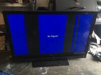 black flat screen TV with black wooden TV stand Portland, 97220