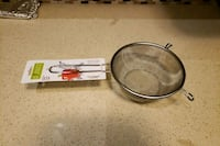 Strainer- Stainless Steel with built in stand Brampton