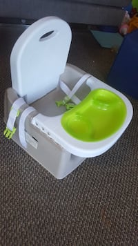 baby's white and green booster seat with tray Surrey, V3R 1V7
