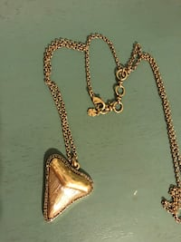 Gold-colored shark tooth pendant necklace