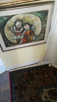 brown wooden framed painting of man and woman Montreal, H3R 3L4