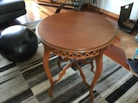 round brown wooden pedestal table Laval, H7P 5V7