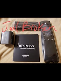 black Amazon Fire TV stick with box