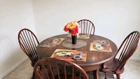 Solid wood dining table with 4 chairs and 2 extra leaves (First come f Gaithersburg, 20878
