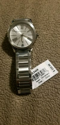 Silver Micheal Kors watch with link bracel St. Catharines, L2M 7J2