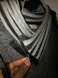 Black and gray sweater from Paris foreign  317 mi