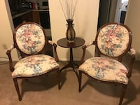 Set of 2 heavy wood curved armed chairs with table and vase centerpiece in excellent condition check out my other items on this site pm me if you interested gaithersburg md 20877 Gaithersburg, 20877