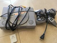 Gray sony ps1 console with controller