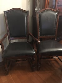 Brown leather chairs they all have studs eight chairs two chairs with arms too big for my table great condition $75 a chair as a set firm on the price Vaughan, L6A 1A9