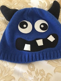 blue and black monster character knit cap