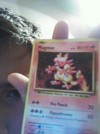 red and white Pokemon trading card 1026 mi