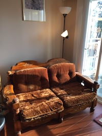tufted brown sofa