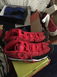 pair of red Nike basketball shoes Germantown, 20874