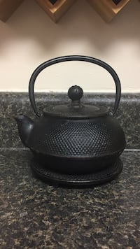 Cast iron teapot and stand