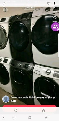two black and white front-load washing machines St. Peters