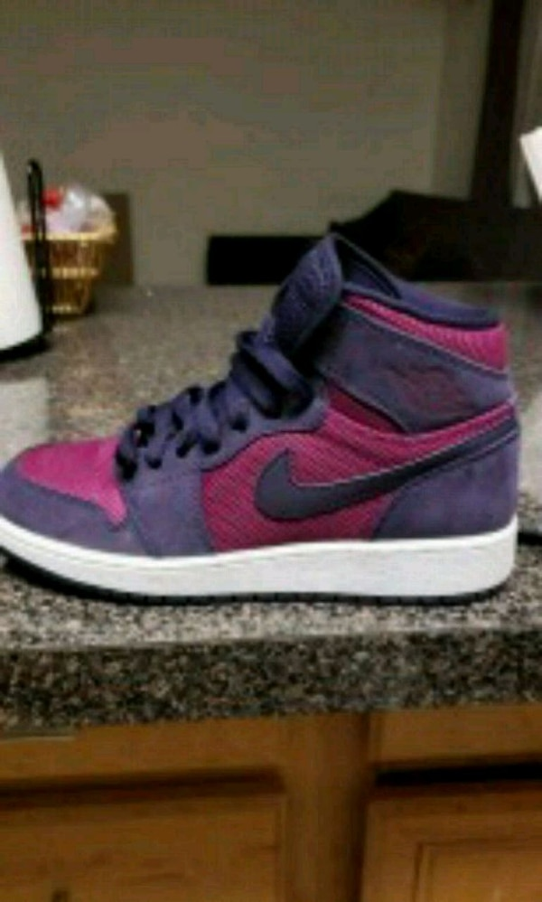 pair of purple-and-red Nike sneakers