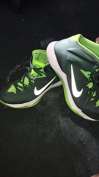 Pair of black-and-green nike basketball shoes Irvine, 92620