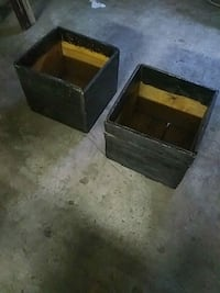 two square black wooden boxes Montreal