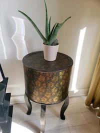 Table side table with hidden compartment.  Metal print and wood. Toronto, M6K 0B3