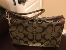 Coach cosmetics bag with paper bag