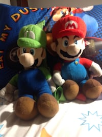 Mario and luigi plush toys.  2 for $10.  They have a zippered storage compartment in the back.   Wappingers Falls, 12590