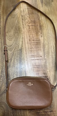 Coach cross body brown leather bag. Almost new, slight tiny stain on the right side. Will never know it's there. Everything else is perfect. New York, 11379