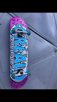 blue, pink, and yellow skateboard Melbourne, 32934