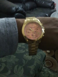 round gold chronograph watch with link bracelet Brampton, L6V 3X3