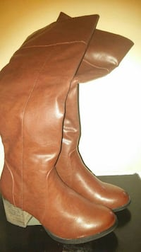 pair of brown leather side-zip chunky-heeled knee-high boots