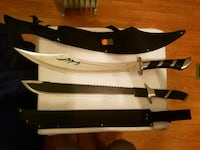 two black machete and gray sword with scabbards Pensacola, 32506