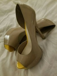 pair of brown leather peep-toe heeled sandals Winnipeg, R2N 1G2