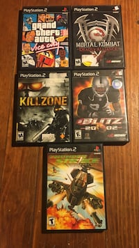 five PS2 video game cases