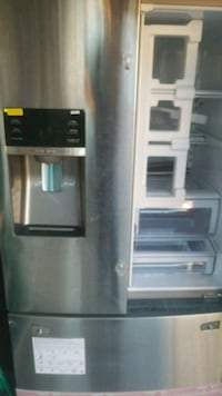 gray side by side refrigerator with dispenser Toronto, M3L 2B8