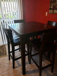 rectangular brown wooden table with four chairs di Manassas, 20109
