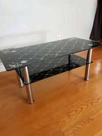 Two tier glass coffee table.