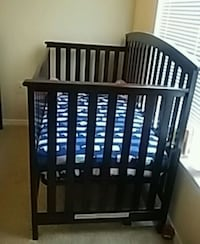 baby's brown wooden crib Cary, 27513